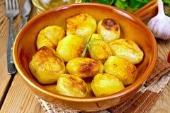 Potatoes fried in ceramic pan Stock Image