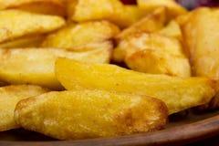 Potatoes fried in lard Stock Photo