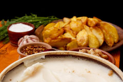 Potatoes fried in lard Stock Photos