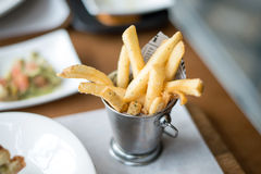 Potatoes fries, Breadsticks in a bucket Royalty Free Stock Image