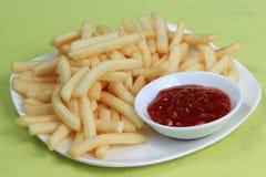 Potatoes fries with ketchup Stock Photos