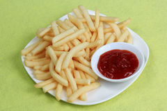 Potatoes fries with ketchup Royalty Free Stock Photography
