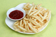 Potatoes fries with ketchup Royalty Free Stock Photo