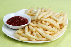 Potatoes fries with ketchup Stock Images