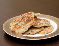 Potatoes fritters on the plate Royalty Free Stock Photography