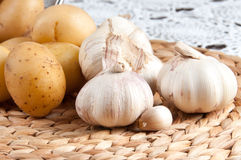 Potatoes and Garlic. On the table Royalty Free Stock Photos