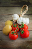Potatoes, garlic and tomatoes Royalty Free Stock Photos
