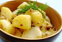 Potatoes garnished Stock Photography