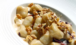 Potatoes gnocchi pasta with walnuts Stock Image