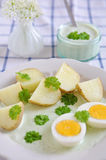Potatoes with green sauce and eggs Stock Photo