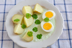 Potatoes with green sauce and eggs Stock Photography