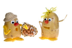 Potatoes with hats Stock Images
