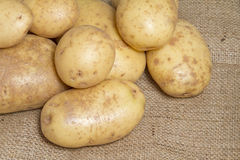 Potatoes on hessian sack Stock Photo