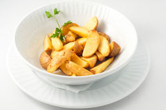 The potatoes at home on the white plate Royalty Free Stock Photography