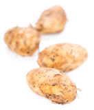 Potatoes isolated on white. Some fresh Potatoes isolated on white background royalty free stock images