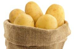 Potatoes in a jute bag. Close up of raw potatoes in a jute bag Stock Photos