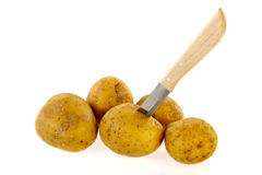 Potatoes with knife Royalty Free Stock Photography