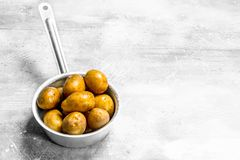 Potatoes in the ladle stock photos
