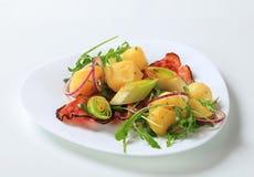 Potatoes with leek and arugula Stock Image