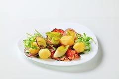 Potatoes with leek and arugula Stock Photos