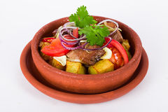 Potatoes meat in clay pot with purple onions Royalty Free Stock Images