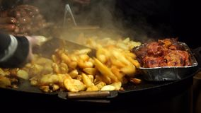 Potatoes and meat cooked stock video footage
