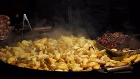 Potatoes and meat cooked stock footage