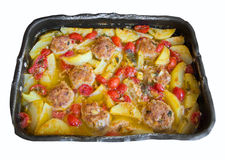 Potatoes and Meatballs in nonstick baking-pan. Royalty Free Stock Photography