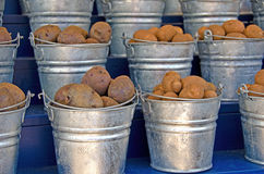 Potatoes in metal pails Stock Photo