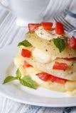 Potatoes with mozzarella, tomato and basil closeup vertical Stock Photo