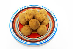 Potatoes on multicoloured plate Royalty Free Stock Photos
