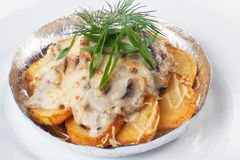 Potatoes with mushrooms in foil  white background mayonnaise cheese. Potatoes mushrooms foil  white background mayonnaise cheese Stock Photography
