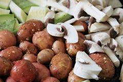 Potatoes, mushrooms and zucchini Stock Photo