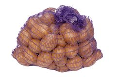 Potatoes in net packing. Some potatoes in net packing stock image