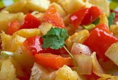 Potatoes O'Brien. Dish of pan-fried potatoes along with green and red bell peppers Stock Photo
