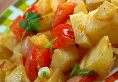 Potatoes O'Brien. Dish of pan-fried potatoes along with green and red bell peppers Royalty Free Stock Image