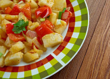 Potatoes O'Brien. Dish of pan-fried potatoes along with green and red bell peppers Stock Image