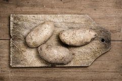 Potatoes on old table. Potatoes on old wooden table, Studio shot Stock Images