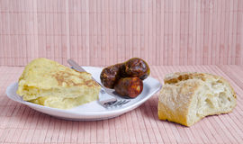 Potatoes omelet or tortilla de patatas and sausage Royalty Free Stock Photo