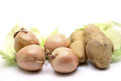 Potatoes and onions. Raw potatoes,onions and salad Stock Photography