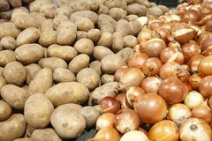 Potatoes and onions in a grocery Stock Photo