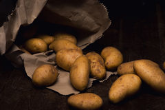 Potatoes out of paper bag Royalty Free Stock Images
