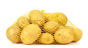 Potatoes in a pack isolated on white background Stock Photo