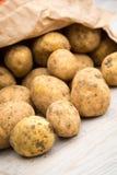 Potatoes in Paper Bag Stock Photos
