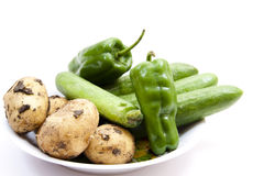 Potatoes with paprika and cucumbers Royalty Free Stock Photo