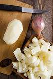 Potatoes peeled Stock Images