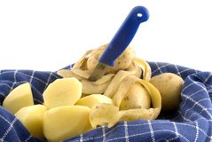 Potatoes peeling Stock Photography