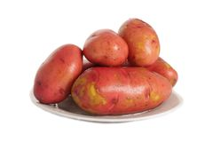 Potatoes in the plate. Isolated group of potatoes on the plate Stock Photos