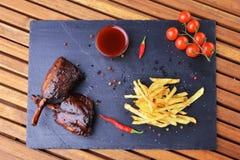 Potatoes and pork Stock Photo