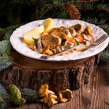 Potatoes with pork medallions and chanterelle sauce Royalty Free Stock Image